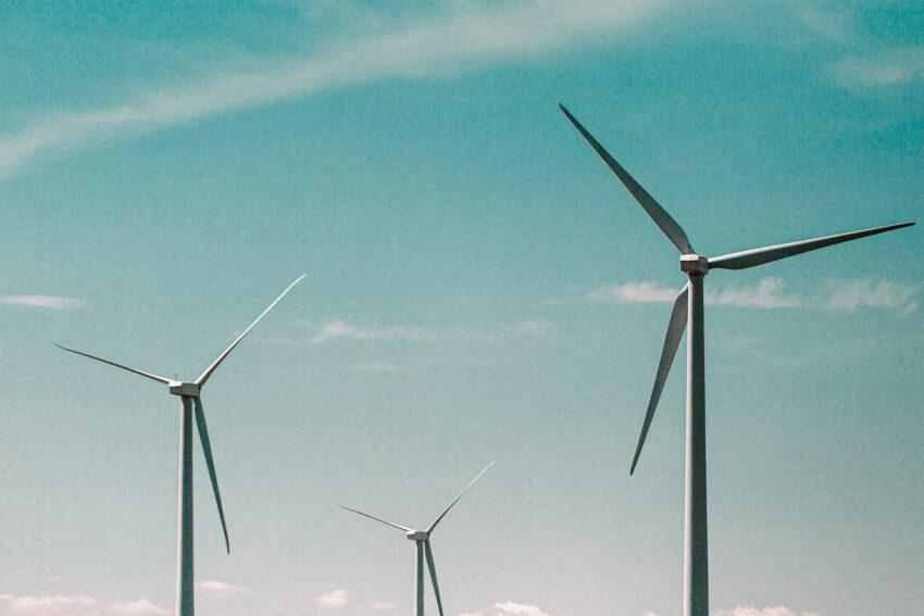 wind turbines under blue sky during daytime